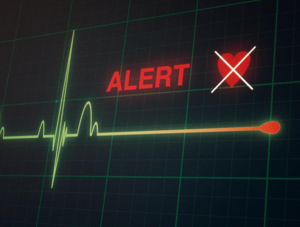 Batimentos cardíacos interrompidos e um coração com um x branco na frente | Morte súbita